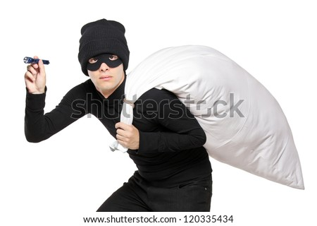 A robber with a bag on his back and flashlight isolated on white background - stock photo