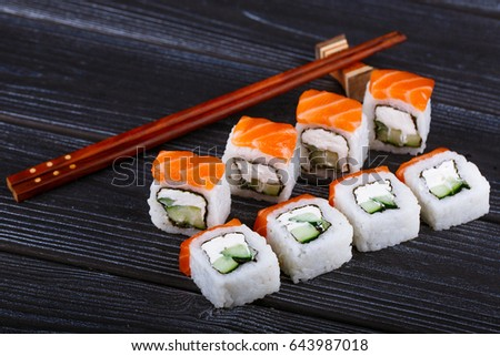 A set of sushi on a dark wooden background. Japanese food