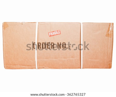 A small packet or parcel for mail shipping isolated over white vintage