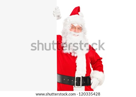 A smiling Santa Claus posing next to a billboard isolated on white background - stock photo