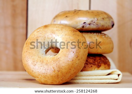 a stack bagels displayed at market place  - stock photo