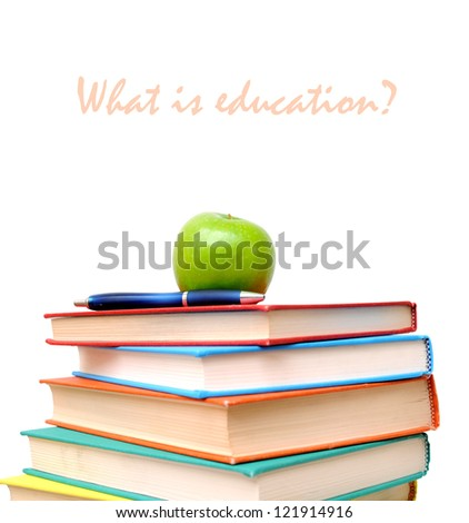 a stack of colorful books and apple isolated on white background