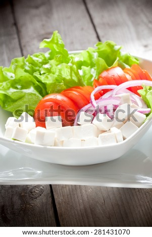 A summer salad with feta cheese - stock photo