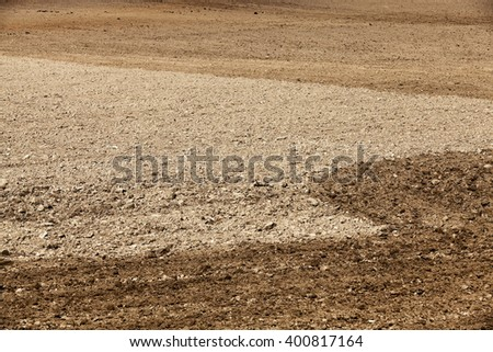 a tractor plowed field agricultural land. Spring. sown. close-up.