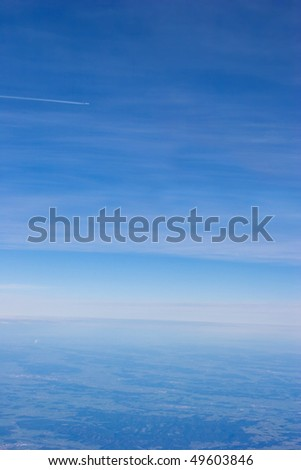 A wing of the plane photographed from a window  on a background of the sky - stock photo