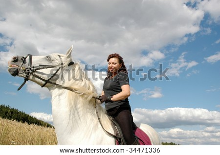 A woman and a fiery horse. - stock photo