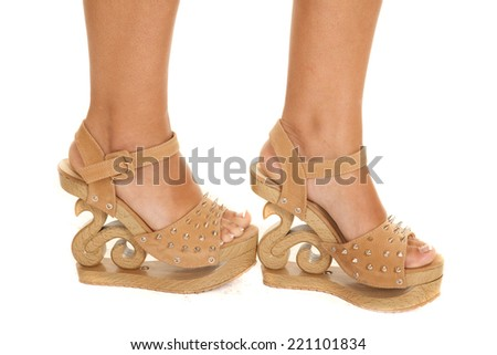 A woman showing her brown stylish shoes. - stock photo