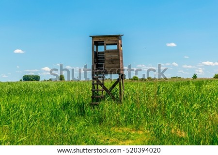 a wooden lookout tower used by birdwatchers next to neuseidlersee in Austria