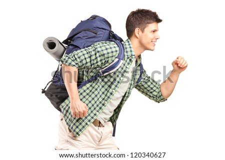 A young hiker with backpack running isolated on white background