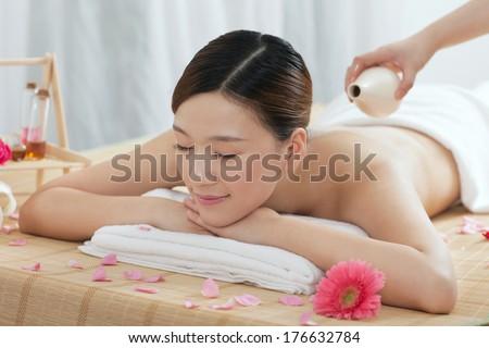 A young woman enjoying massage - stock photo