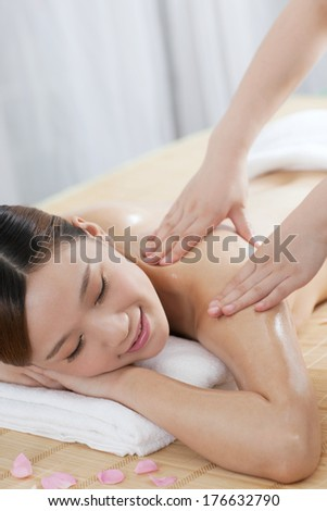 A young woman enjoying massage