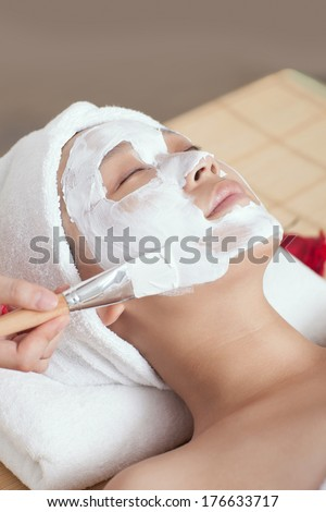 A young woman enjoying spa mask