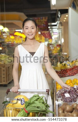 A young woman in the supermarket shopping