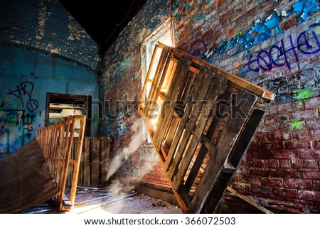 """Abandoned"" is a high dynamic range images of the inside of an abandoned building.  Light through the window highlights the dusty nature of this abandoned building."