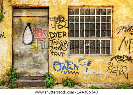 Abandoned shop exterior covered with graffiti in Athens, Greece - stock photo