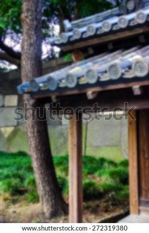 """Abstract Background Blurred Image"" Traditional Japanese roofing structures showing ornate tiles.  (Blur style image) - stock photo"