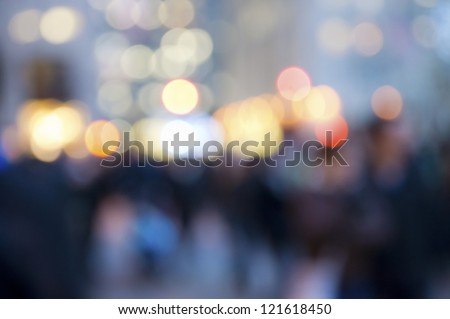 """Abstract Crowd and Lights"" An abstract look at the Christmas lights and the people in Rockefeller Center in Manhattan. - stock photo"