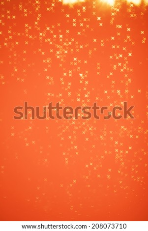 Abstract glitter festive christmas texture with shining stars on golden background, de focused - stock photo