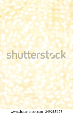 Abstract Sparkling Golden lights with bokeh effect. Yellow boke circles with defocused background.  Splashes of champagne  - stock photo