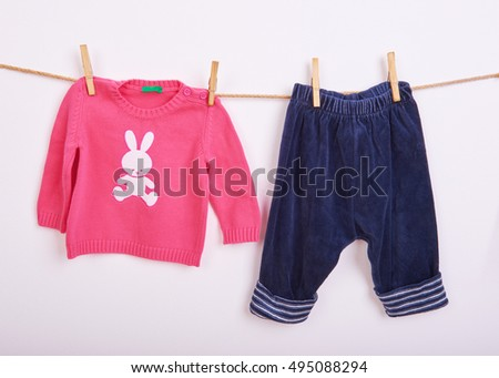 ?aby goods hanging on the clothesline, white background