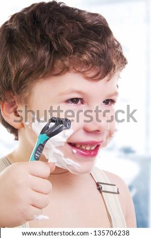 Adorable child shaving - stock photo