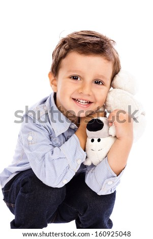 Adorable little boy holding  his favorite toy  on white background - stock photo