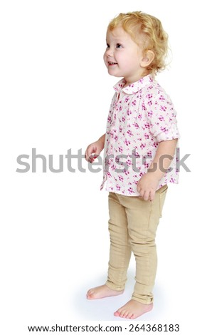Adorable little girl photo in full growth. - isolated on white background