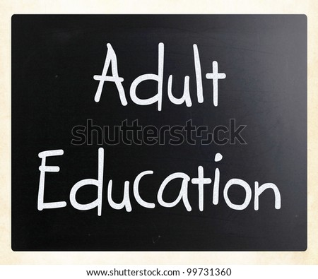 """Adult Education"" handwritten with white chalk on a blackboard"