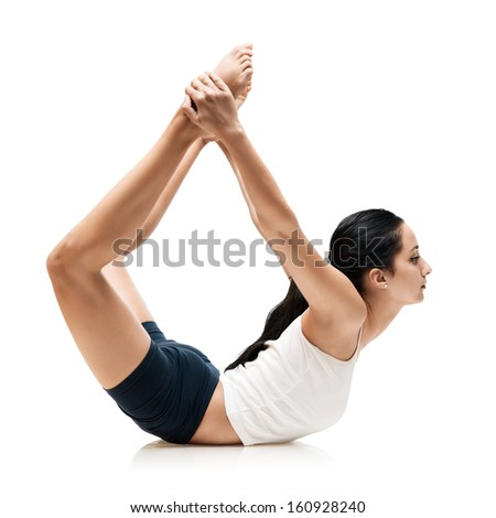 adult woman in dhanyrasana yoga position isolated - stock photo