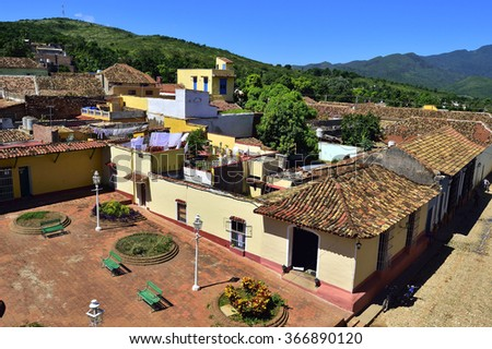Aerial view over the roofs of Colonial town Trinidad, Cuba. UNESCO World Heritage Site. Colourful houses of the Trinidad, Cuba - stock photo