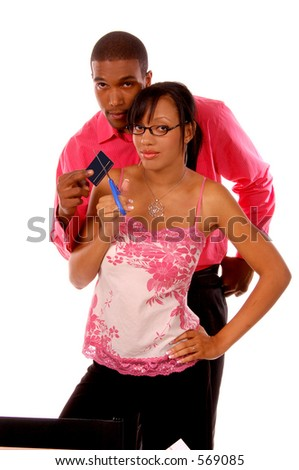African American couple cutting a credit card in half.  Card is blank and ready to receive your info.