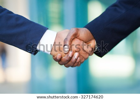 African businessman shaking hands with a caucasian one - stock photo