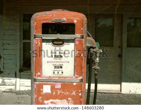 aged and worn vintage gas pump                               - stock photo