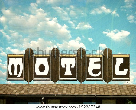 aged and worn vintage motel sign                               - stock photo