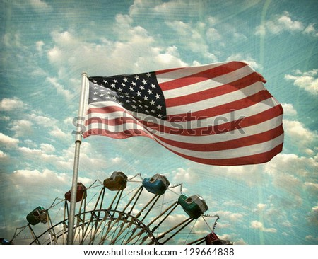 aged and worn vintage photo of american flag and carnival ferris wheel - stock photo