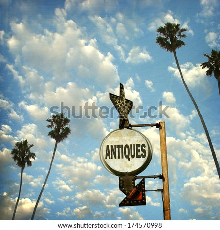aged and worn vintage photo of  antiques sign                             - stock photo