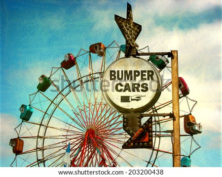 aged and worn vintage photo of bumper cars sign at carnival with ferris wheel                               - stock photo