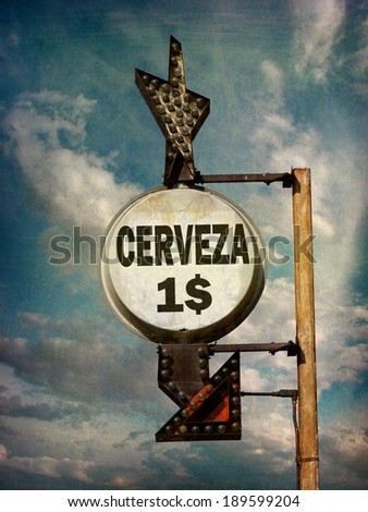 aged and worn vintage photo of cerveza (beer) sign                         - stock photo