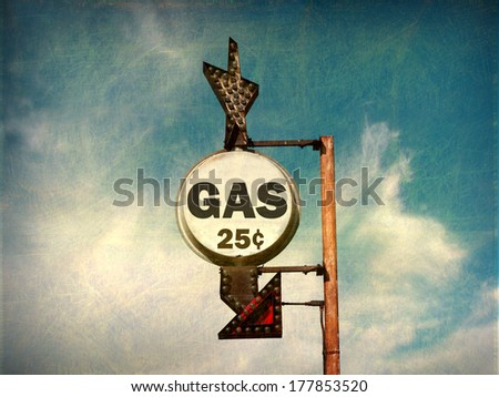 aged and worn vintage photo of cheap gas sign                             - stock photo