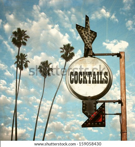 aged and worn vintage photo of cocktails sign and palm trees                               - stock photo