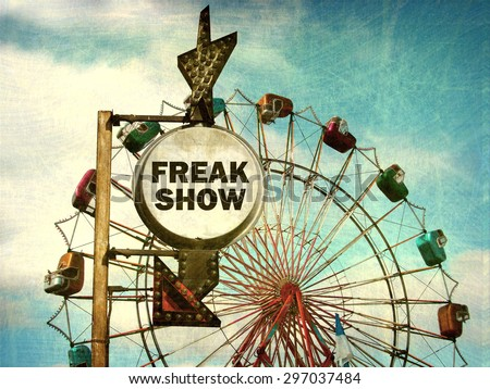 aged and worn vintage photo of freak show sign at carnival