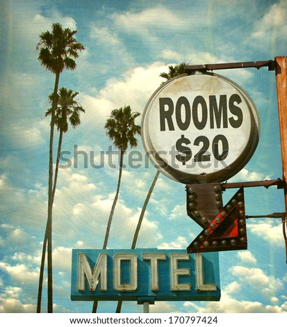 aged and worn vintage photo of motel rooms sign with palm trees                              - stock photo