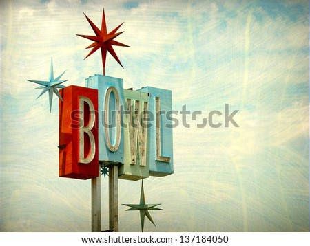 aged and worn vintage photo of neon bowl sign - stock photo