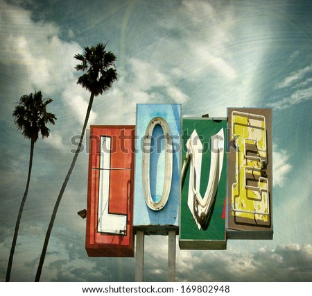 aged and worn vintage photo of  neon love sign with palm trees                             - stock photo