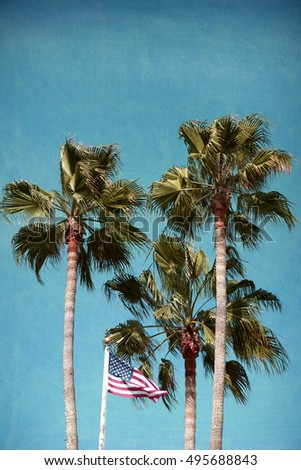aged and worn vintage photo of palm trees and American flag