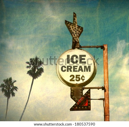 aged and worn vintage photo of retro ice cream sign with palm trees                              - stock photo