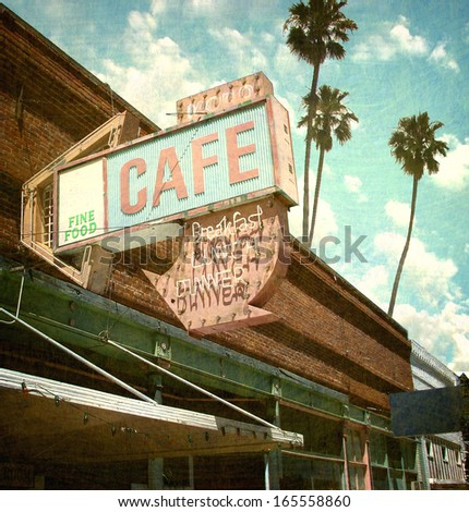 aged and worn vintage photo of retro neon sign and palm trees                               - stock photo