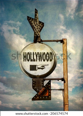 aged and worn vintage photo of retro sign pointing towards Hollywood                             - stock photo