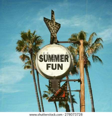aged and worn vintage photo of summer fun sign with palm trees                              - stock photo