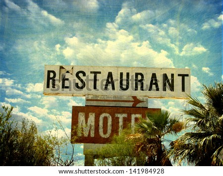 aged and worn vintage restaurant and motel sign - stock photo